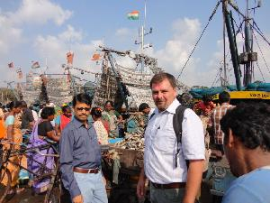 Dr Stobberup (right) in Visakhapatnam port, India, with Dr. Ansuman Das of the Indian Fishery Survey. In the background are tra